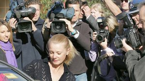 Lucy Dudko dogged by the media as she is released from prison in 2006 (photo: Herald Sun, 1 June 2013)